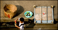 Boy Passing Food Stall Dishes