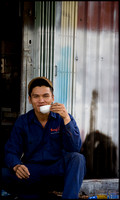 Worker takes a break for tea and smoke in Da Lat city