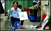 Mr Thai , an artist who has been selling his works on Dong Koi Street for over 58 years.